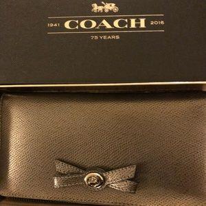 Coach Gunmetal Turnlock Bow Wallet